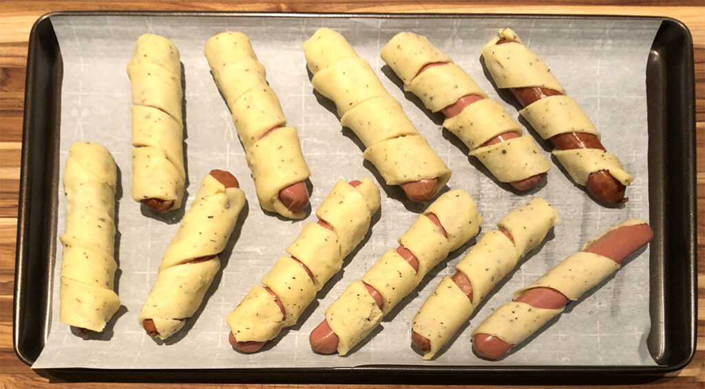 Freshly wrapped Low Carb Pigs In a Blanket ready for the oven.